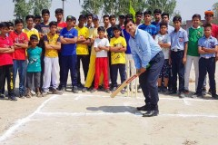 Sport officer enjoy cricket with children