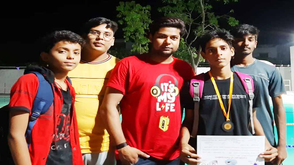 mrd international school student won medal in swimming activity student sumit with coach Sharukh Sharif